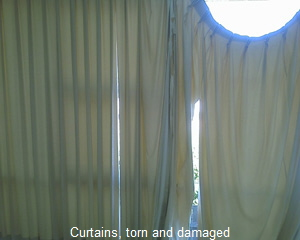Curtains Malicious damage